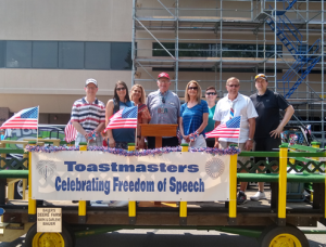Central Wisconsin Area Toastmasters Clubs members helped 'Celebrate Freedom of Speech' in July 4, 2021 Parade in Stevens Point. From left: Sentry Club #4596 members: Cole Monroe, Lacy Skrzeczkoski, Jenny Prideaux; Stevens Point Club #570's Ken McKenzie, Carol Adams, Carol's daughter, Tiffany Adams, visiting from Little Rock, AR; and Dick Hawley and Brandon Birrenkott; both also from the Sentry Club.